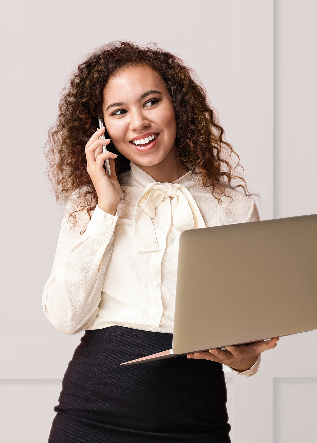 Young businesswoman with laptop talking by phon